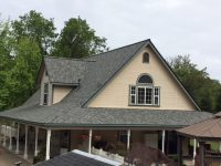 New roof installation with green trim and high pitch near Oakdale, California