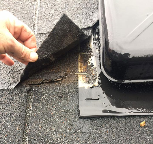 Uncovering damaged flashing during roof repair in Plleasanton