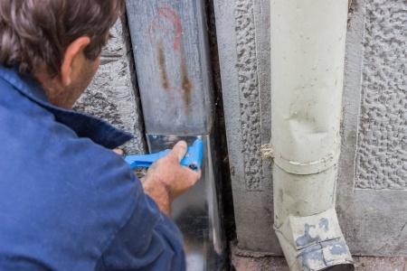 repairing a gutter's downspout