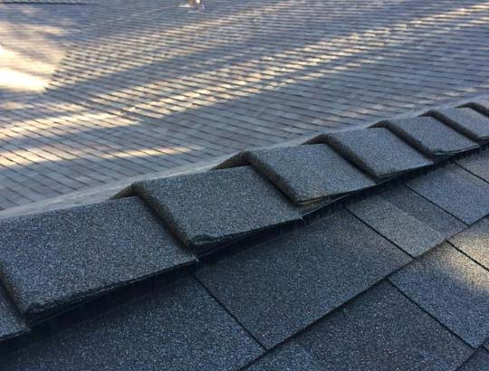 Ridge cap replacement by a roofer in Copperopolis