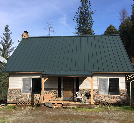 ASC Skyline standing seam roof installation in forest green