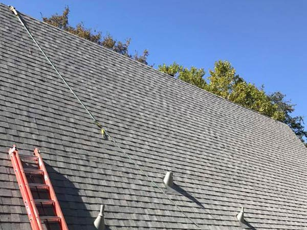 a roofer in Sonora is adding the final touches to the roof