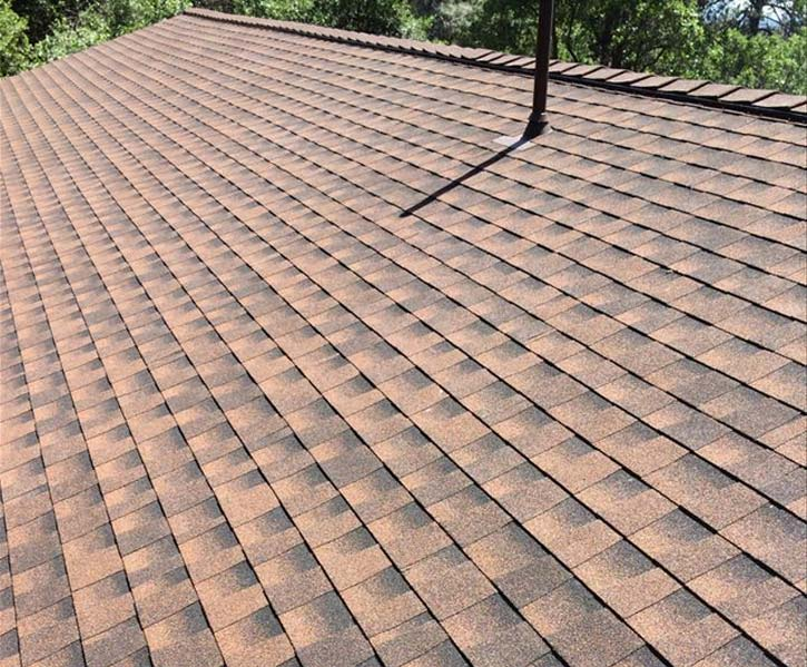 roof with red shingles repaired by our roofing contractors