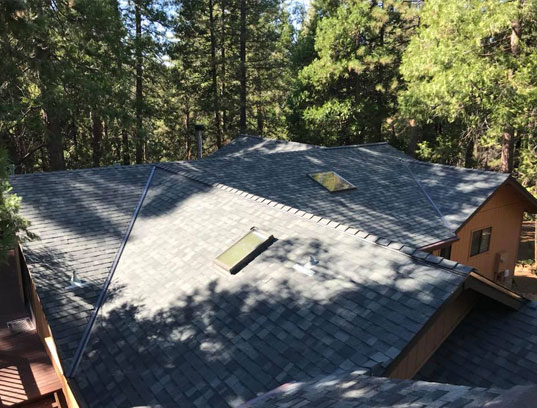 Roof installation in Tuolumne City with multiple skylights
