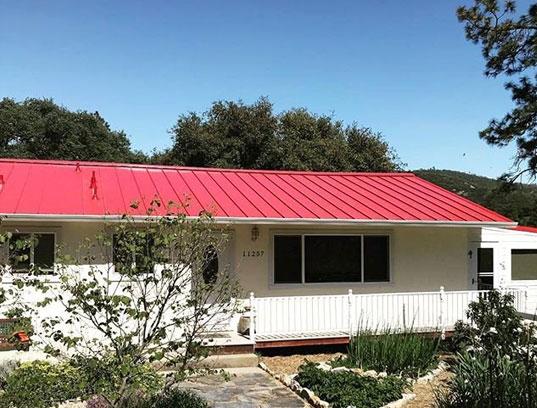Red metal reroofing in San Andreas