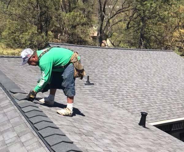 one of our roofers in Manteca is adding new shingles