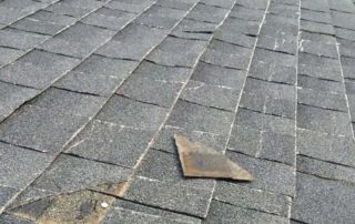 missing shingles are a sign for needing a roof replacement