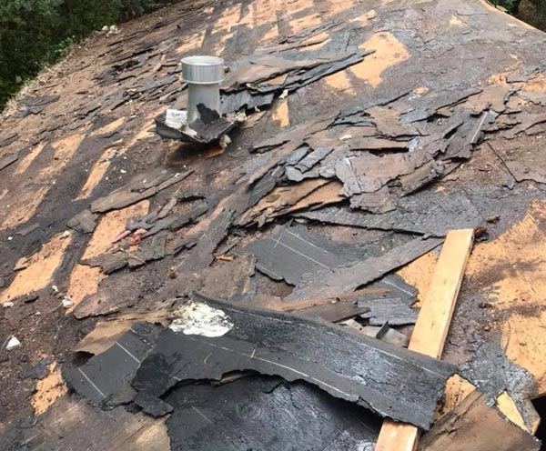 broken shingles are a sign for an emergency roof repair