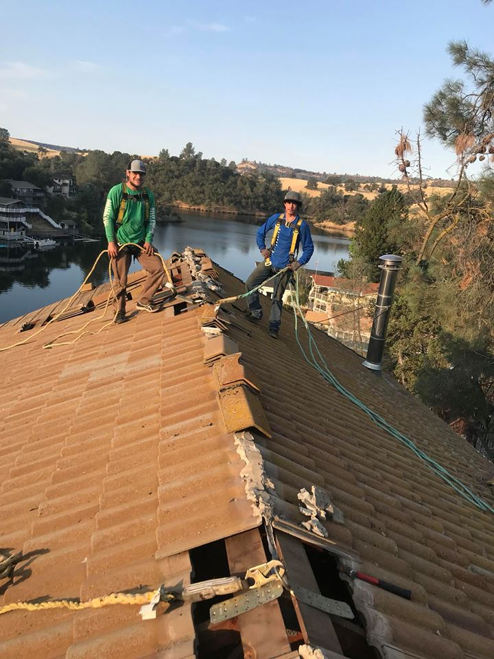 two professional kelly roofing contractors completing repairs on a residential home in lodi ca