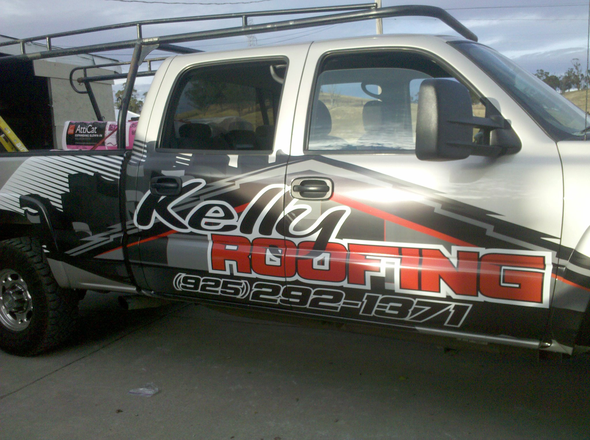 Kelly roofing used to transport commercial roofers and roofing materials